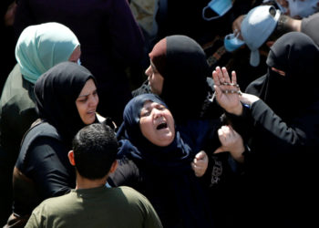 The mother of two Palestinian fishermen Hassan and Mahmoud al-Zazoua reacts during their funeral after their bodies were returned from Egypt, in the central Gaza Strip September 27, 2020. REUTERS/Mohammed Salem TPX IMAGES OF THE DAY